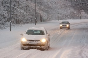 Two Cars Driving in Snow