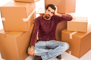 Stressed Young Man on Moving Swamped with Boxes